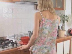 Busty Blonde Girl Stripping In A Kitchen