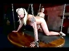 Mistress fucks a bound slave girl